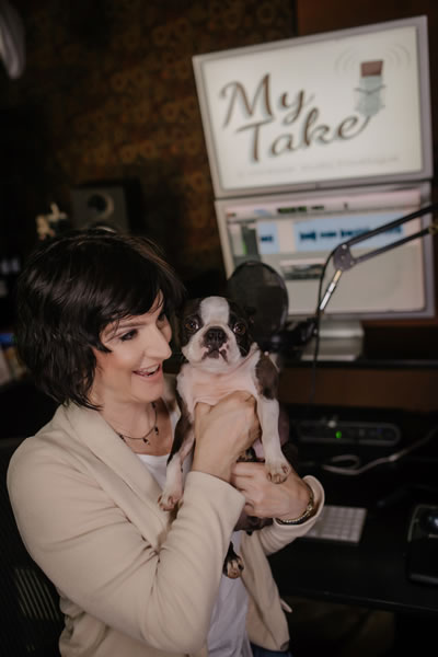 Voice actor Paula Tiso and her dog Journey in her studio.
